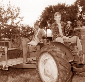 Young Clif Clendenen on the tractor